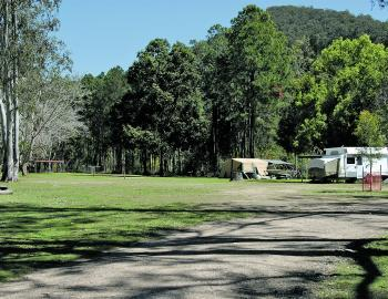 Shade is at a premium here, but the campers have been wise enough not to set up under one of those big eucalypts.