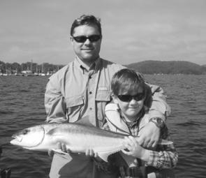 Young Tex with his proud Dad. This was Tex's first kingfish and within 15 minutes of pulling the fish in, he was so tired he was ready for a nap.