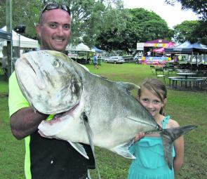 Anthony and Kyra Poacher with the heaviest fish at last years' Hervey Bay Competiton: a 13.76kg giant trevally weighed in by Michael Baker.