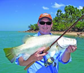 Adam Royter with a plastic munching Weipa barra caught of the shallow reefs and rubble adjacent to the beach.