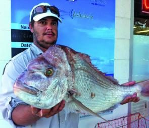 Tim Hutchison with his personal best snapper, and 83cm and 7kg specimen caught from Mud Island.