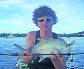 Chris Lacey with a small trevally typical of those being caught in Woods Bay early in the day.