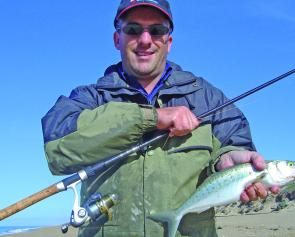 The author with a quality salmon taken on a green Lazer lure from Flamingo Beach during a morning session with Will Thompson.