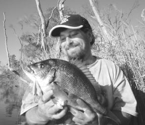 The author about to return a 44cm bream caught on a hard body.
