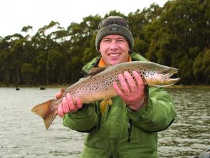 Grant Garwood with a nice early season penstock brown trout.