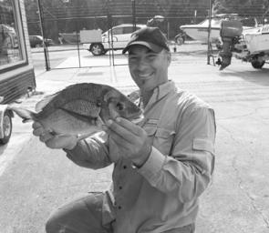 Andrew Buresch from Belmont with a 1.8kg Swansea Channel bream caught on a pumpkinseed 3