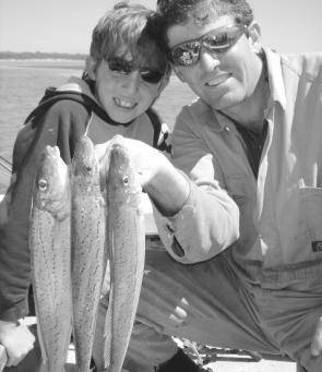 Young Jack Moon and his dad John hold up a couple a lovely whiting they caught inside McLoughlins.