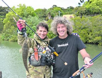 Dave with Graham and his custom made rods with a decent sized flatty.
