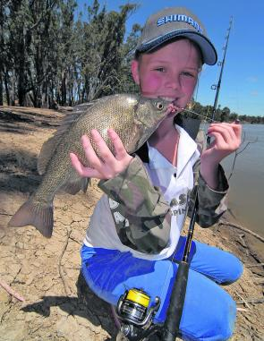 Kenna Mackenzie with a solid silver perch she caught from the Murray River on worms.