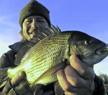 Scott Pettigrove with a golden nugget of bream.