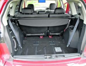 Cargo space is a big feature of the Outlander. With the rear door opening upwards, it's easy to access the area. Note the large sub woofer for the beats.