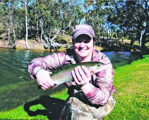 Leanne Cowan with her first-ever trout on fly, caught at the conclusion of her fly fishing course at Rainbow Springs.