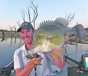 Tim and a decent Copeton gold caught on a Mazy in windy black colour.