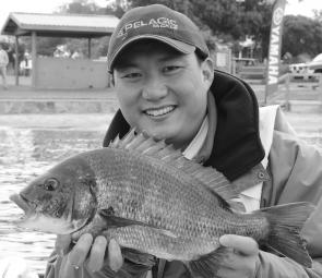 Sing Ling from Team SSBB with one of the great bream that helped to bring his team home with a wet sale on Sunday.