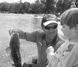 Ben Cockburn, 3, with his first Lake Macquarie flathead, a 65cm beauty, which was then released.
