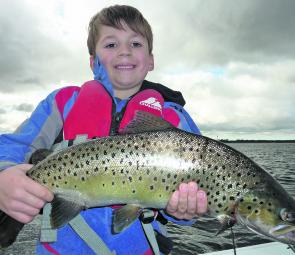 Zach Stevens outdid his brother with this whopping Tooliorook brown trout of nearly 3kg on an orange Tassie Devil.