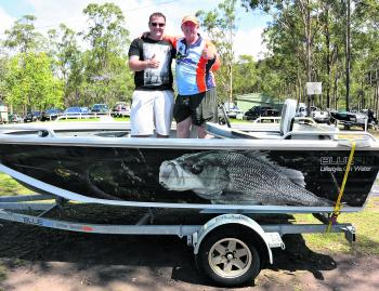 Richard Gibson didn't catch a fish all weekend, but he caught the lucky prize draw, which was the 4.5 Bluefin Tournament Drifter, powered by a 40hp Mercury Fourstroke on a Dunbier trailer. Brad Richey, owner of Bluefin, was on hand to present the prize to