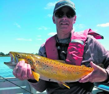 Steve Angee with a lovely brown trout caught on a mudeye suspended under a bubble float.