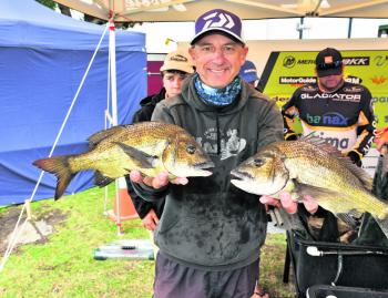 Mario Vukic proudly holds a pair of bream that helped him finish 2nd at Mallacoota.