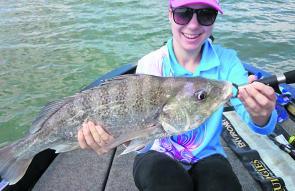 Brittany Sossai with a solid grunter she caught recently.