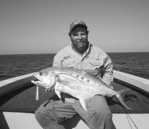 The author with a solid queenfish caught on a Trollcraft popper.