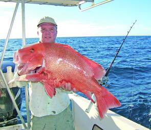 Beating the sharks for once, we finally managed to get this magnificent 10kg red emperor to the boat.