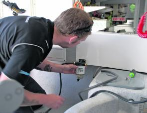 The WaterScreen Nano fuel filter was installed out of the way behind the gunwale beside the skipper's seat, yet the bulb was easily visible for inspection. Here the Bay Honda techs measure out the drill holes. Measure twice drill once – you bet!