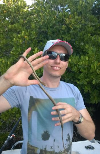 It's not always fish that get boated when you're tucked in tight to the mangroves. Damien found this cute little tree snake.