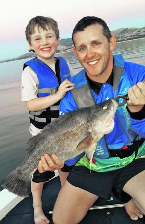 Cliff Karnatz and his son with a lovely yellowbelly caught at Lake Hume on a wide body McGrath lure. The smiles in this photo capture what fishing is all about.