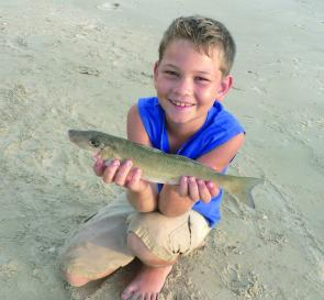 Riley Hansen with a decent whiting. May is great for beach fishing.