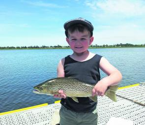 The author's son Max Stevens with a lovely 1.5kg brown trout from Lake Wendouree.