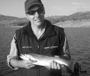 Glen Raynor with a kilo rainbow trout caught trolling a No 82 Tasmanian Devil.