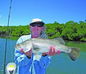 Rob Cannon, from Cairns, with a sample of the barra that have been going off in recent months.