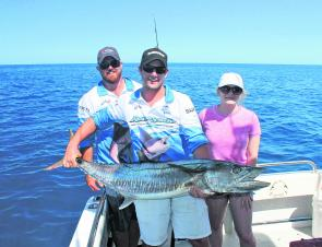 The Renegade crew helping a happy (and worn out!) customer hold up her nice 22kg Spanish mackerel.