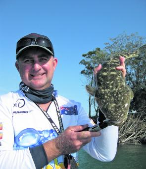 Michael Fox from the Flathead Assassins with a typical flathead his team found in the Classic.
