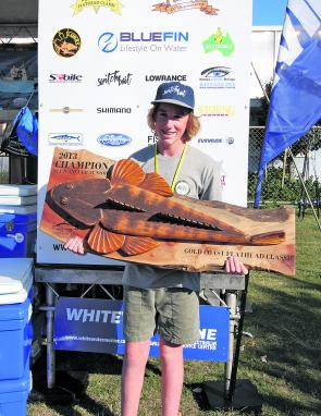 Champion Club Junior, Cooper Sands is presented with one of the best trophies going for his efforts at being the best junior from the Gold Coast Sportfishing Club in the event.