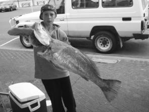 Jonah Gagnuss with a 13kg jewfish caught on a soft plastic from the northern breakwall at Harrington.