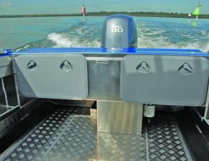 Additional cockpit storage is supplied in the compartments of the Profile's transom shelf.