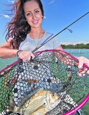 Seamo's daughter Emma seems happy with the net job on this 1kg bream. A Cranka Crab between the rack rails can create a few hairy moments, but it all worked out in the end.