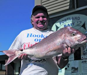 Local anglerTerry Alberts with a kicking snapper caught off the Lee breakwater.