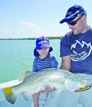 Anthony Hargrave and son Oli with typical Norman River barra trolled up on a JJ Aussie Jumper.