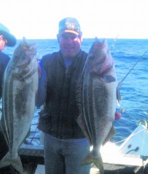 Josh Baker of Horsham with two great Tassie trumpeter of 10kg caught while bottom bouncing on the Shelf.