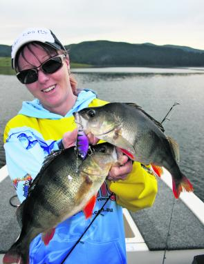 Sharon Burgess shows off two monster red fin caught on the cast in Burrinjuck Dam.