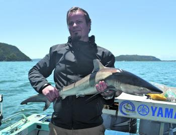 Jake pictured with one of the many sharks that have recently been caught on Pittwater.