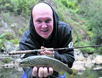 The author with a nice trout taken from a tributary of the Kiewa River. The tributaries have been fishing well lately but will slow down once the warmer weather arrives.