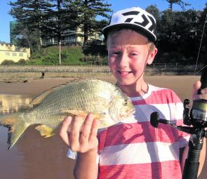Blake Robertson with his first legal fish – a beautiful 35cm beach bream. Note the rocks in the corner; often a great haunt for this species.