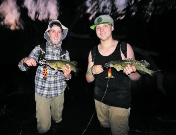 Something you don't see every day – a double hook-up on surface lures. Hugh Blythe caught his cod on a Koolabung Codwalker and Will O'Connor caught his on a Rochows Timber surface lure, made by Tom Rochow – a very talented Beechworth High School student.