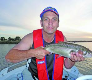 The author with a Lake Tooliorook 1.5kg rainbow trout caught on a pink Tassie Devil lure.
