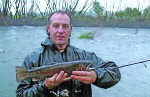 Mick Cavallaro with a nice rainbow taken from the raging torrent behind him.