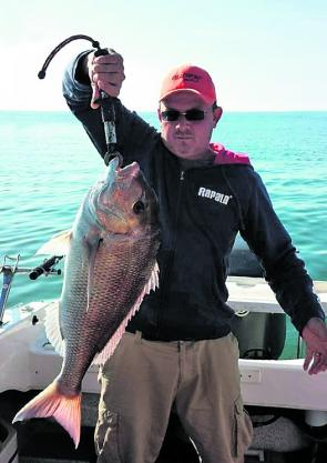 John Woolf with his epic 6kg snapper. It's a surprize catch but not too unusual.
